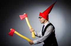 Man with axes in funny concept - stock photo