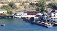 Submarine and the warship on the anchor parking in a bay of Sevastopol Stock Footage