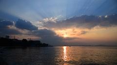 Sunset light shine with cloud at sea, Sriracha, Chonburi, Thailand (Blur backgro Stock Footage