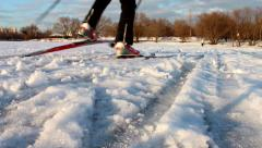 Cross-country skiing on a flat surface of a pond on a warm day Stock Footage