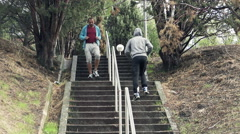 Two men jogging the stairs in park HD Stock Footage