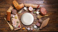 Assortment of meat products. variety of smoked meats. on a wooden board. Stock Photos