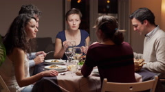 Young people dining together Stock Footage
