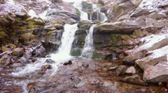 Waterfall in mountain locality in winter Stock Footage