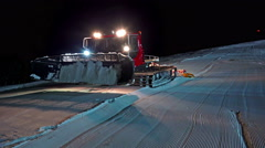 4k Snowcat Ratrak Forms The Kicker at night Stock Footage