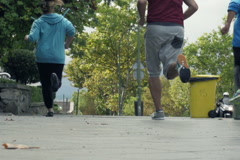 Young people jogging in city NTSC Stock Footage