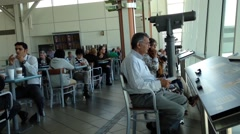 People waiting for thier flight at YVR airport Stock Footage