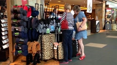 One side of passengers inside gift shop for buying luggage Stock Footage