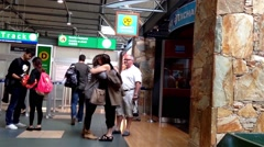 People say goodbay in front of security checkpoint gate Stock Footage