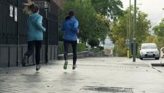 Young people jogging in city HD Stock Footage