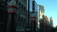 Bus passing in the City of London, morning Stock Footage