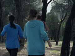 Young people jogging in park NTSC Stock Footage