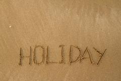 Happy Holidays Message on Beach - stock photo