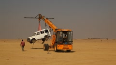Crane with Car at Desert Stock Footage