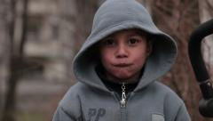 Profile of little gypsy boy making different facial expressions. Close up. Stock Footage