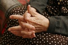 Hands of the elderly woman - stock photo