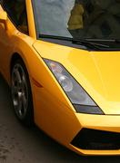 Magnificent yellow automobile - stock photo
