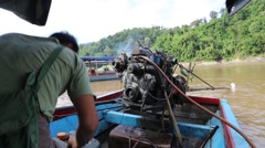 Asian man preparing his boat and motor for navigation Stock Footage