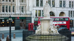 Modern Bus passing at Statue of Queen Anne, St Paul's Stock Footage