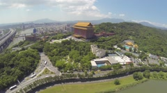 High drone aerial over Taipei Grand Hotel - sunny day Stock Footage