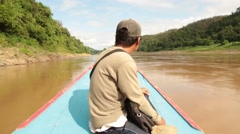 Boat navigating across the river while Asian man sitting in front Stock Footage