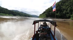 Boat with Thailand flag navigating across the river - stock footage