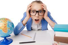 Shocked overwhelmed student wearing glasses - stock photo