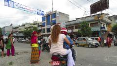 Congested street traffic  with crowd of scooters in Asia Stock Footage