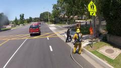 Firefighter working putting out vault fire responding action Stock Footage