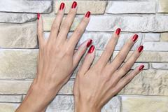 Female Hands - after manicure treatment - stock photo