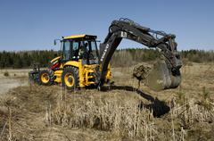 Backhoe loader digging Stock Photos