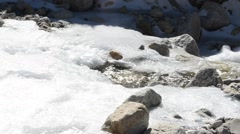 Rushing Water In Frozen River Ice Crevice Stock Footage