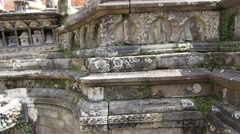 Carved religious details on a stone fountain in Kathmandu, Nepal Stock Footage