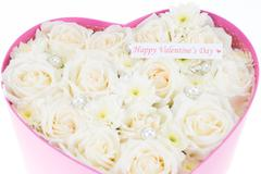 White roses and pearl and diamond held in the heart shape box - stock photo