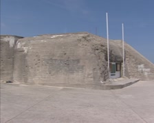 Arromanches, France - Atlantic Wall, German Casemate + pan Gold Beach and ocean Stock Footage