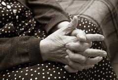 Hands of the elderly woman Stock Photos