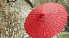 Fashion Model With Long Curly Hair Poses With Traditional Red Japanese Umbrella Stock Footage