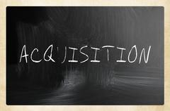 """""""Acquisition"""" handwritten with white chalk on a blackboard Stock Photos"""