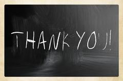 """Thank you"" handwritten with white chalk on a blackboard Stock Photos"