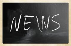 "The word ""News"" handwritten with white chalk on a blackboard - stock photo"