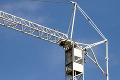 Crane on a blue sky background - stock photo