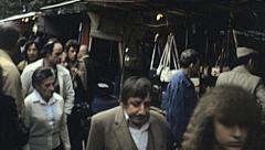 Paris 1978: crowd in a flea market Stock Footage