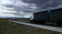 Karoo Landscape with trucks and cars and distant rain Stock Footage