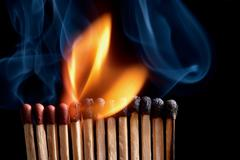 Burning matchstick - stock photo