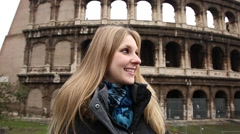 Happy blonde tourist at the Colosseum in Rome, Italy. - stock footage