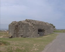 Remains of German casemate at Atlantic Wall + pan ruins at Pointe du Hoc Stock Footage