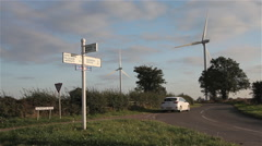 WHITE CAR LEAVES COUNTRYSIDE JUNCTION, GILMORTON, LEICESTERSHIRE Stock Footage