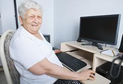 Stock Photo of A senior person in front of his computer