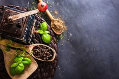 old mill and wooden spoons with spices - stock photo