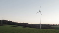 Wind turbine harnessing clean green wind energy sunset evening light - stock footage